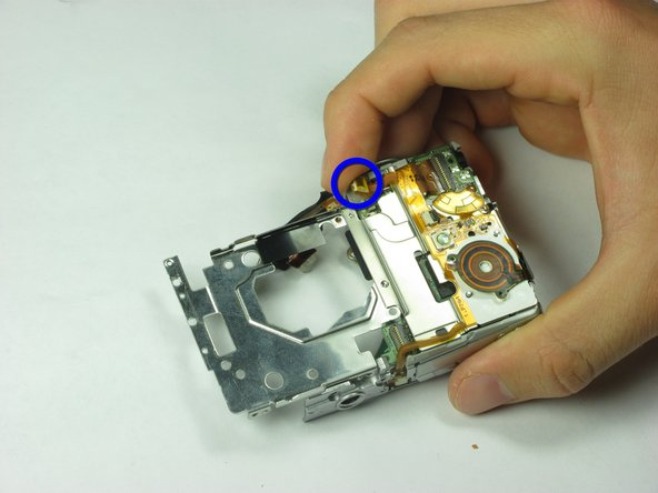 Image 1/2: Gently remove the shutter release component from the camera.