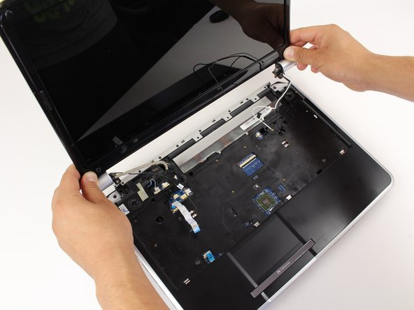 Lift the entire display screen straight up using both hands.