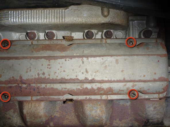 "In order to remove the valve cover, locate the 4 bolts which hold it in place and remove them using a 7/16"" socket or wrench."