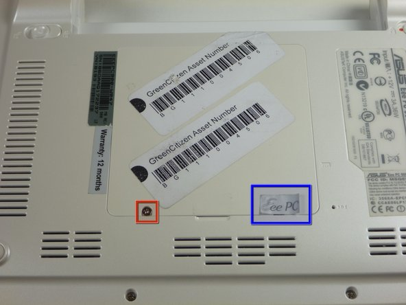 Image 1/1: There may be a sticker covering one of the screws. If not, proceed to step 5.