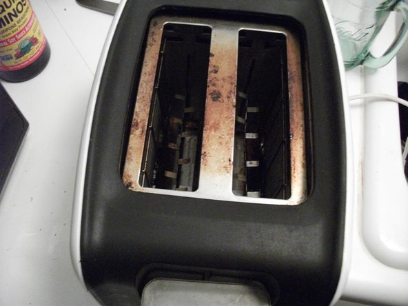 Look down into the bread slots and assure that the metal tongues are not bent or crooked.