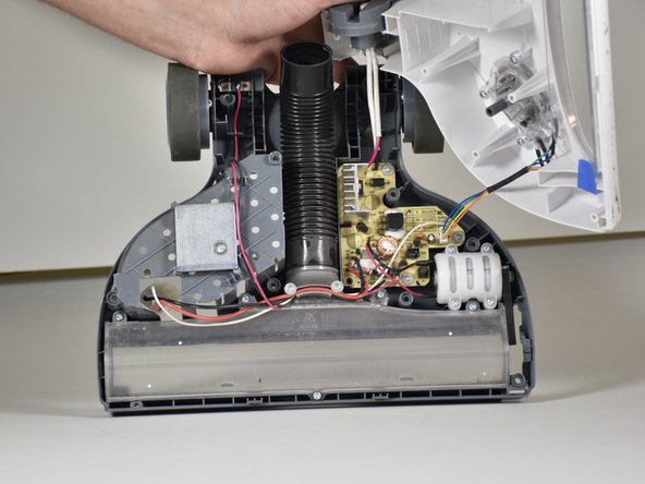 Remove the 12.2 mm Phillips #1 screws holding the motor in place and remove the motor by pulling directly upwards.