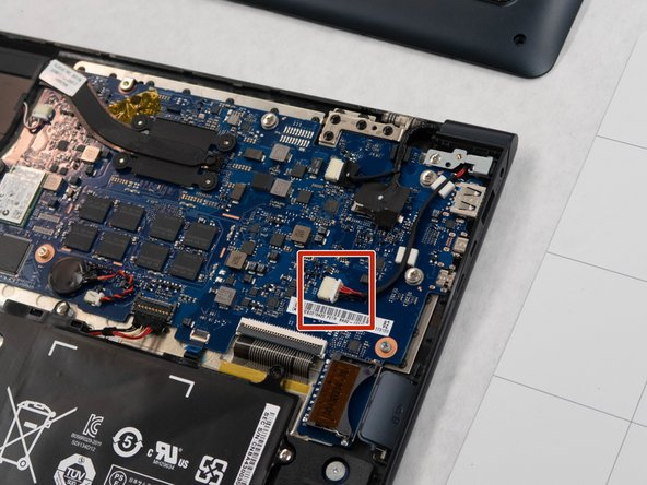 Using your hands, remove the cord that connects the charging port to the motherboard.