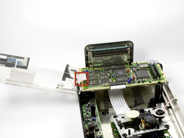 Image 3/3: There is a wire strip running through the metal plate that is soldered to motherboard and power supply board. The plate cannot be completely removed. Do NOT force plate upwards. All the ribbon cables can be safely unplugged by simply pulling them out of their slots.