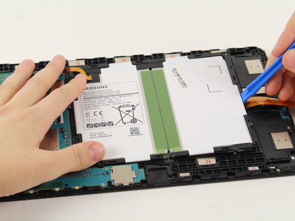 Slide a plastic opening tool under the bottom of the battery close to the speakers and lift up.