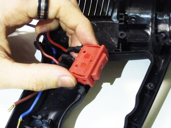 Squeeze the tabs on either side of the power switch to remove from the casing.