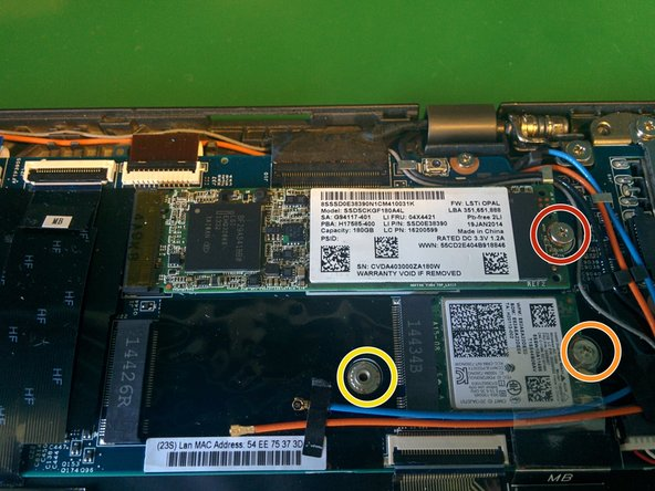 Remove the phillips screw and remove the M.2 SSD from the motherboard. (Intel® SSD 530 Series - SSDSCKGF180A4L)