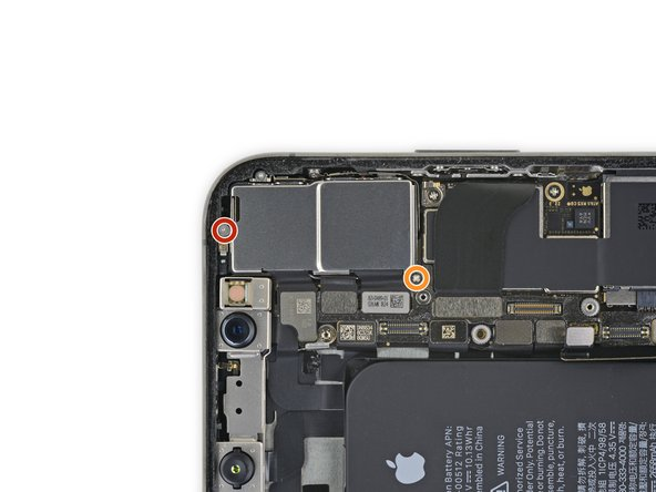 Remove the two screws securing the rear camera cover: