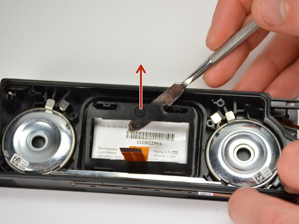 After undoing the tabs on one side,  pull up and away from the side that is still locked in place. This will remove the battery housing.