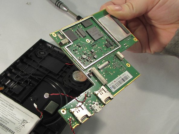 Lift motherboard out of device using plastic opening tools.