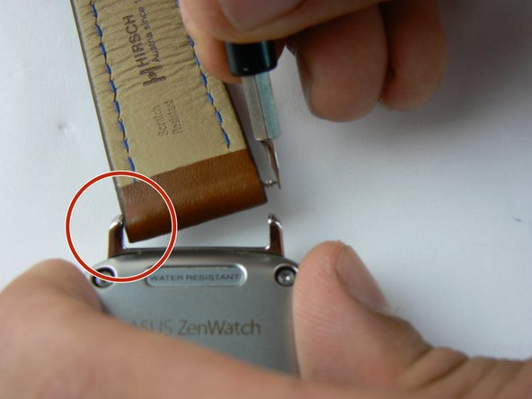 Using the 1.5mm flat head screwdriver compress the spring bar until you can slide the band in between the bars on the watch case.