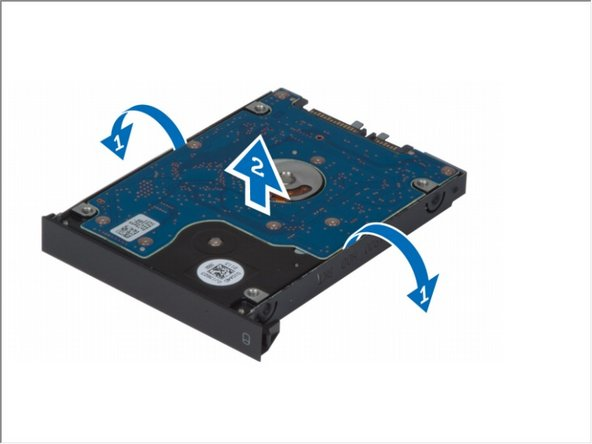 Flex the hard-drive bracket outward and pull out the hard drive from the bracket.