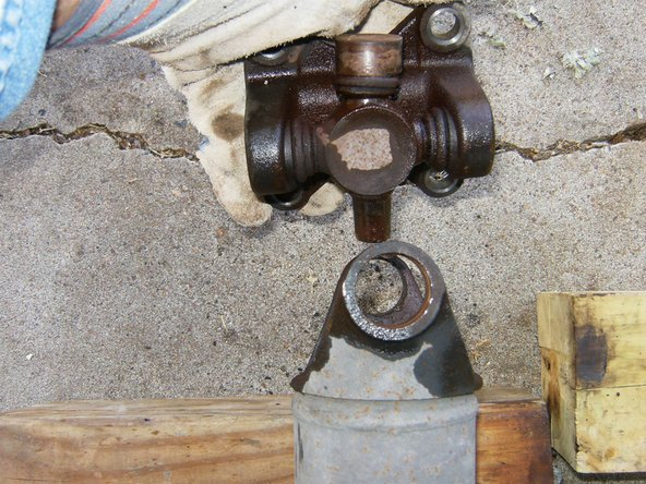 Remove the yoke form the driveshaft by angling it so it will clear the bearing surface.