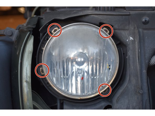 Image 1/2: Use a star bit screwdriver to unscrew the .164-18 x .625 mm star bit screws around the headlight, and make sure you place screws somewhere safe.