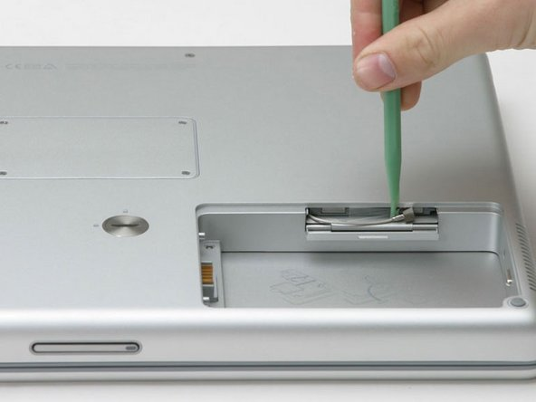 Use a spudger or flathead screwdriver to disconnect the Airport antenna from the card.
