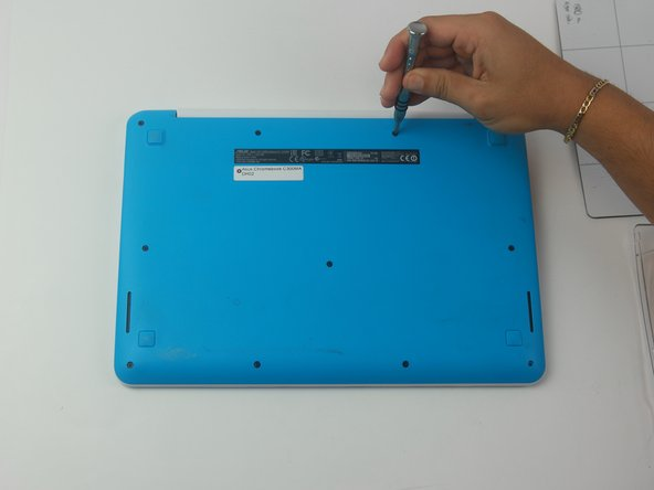 "Using the Phillips PH #000 screwdriver, remove the 11 ""4mm"" screws on the back of the device."
