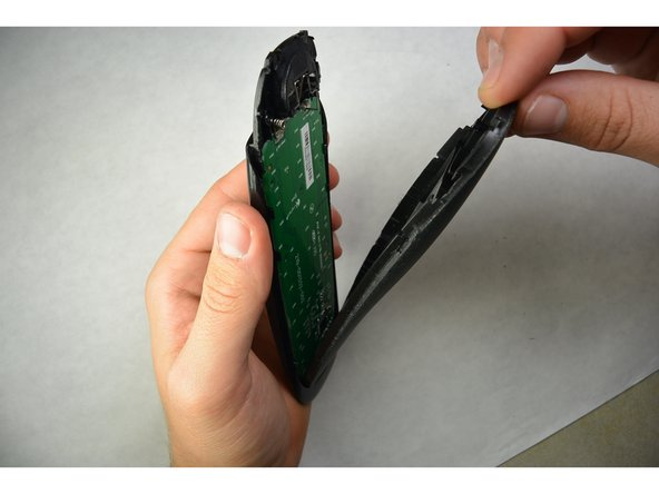 Use a flat screwdriver or a prying tool to  split the remote and separate the two pieces. Start  from the bottom.