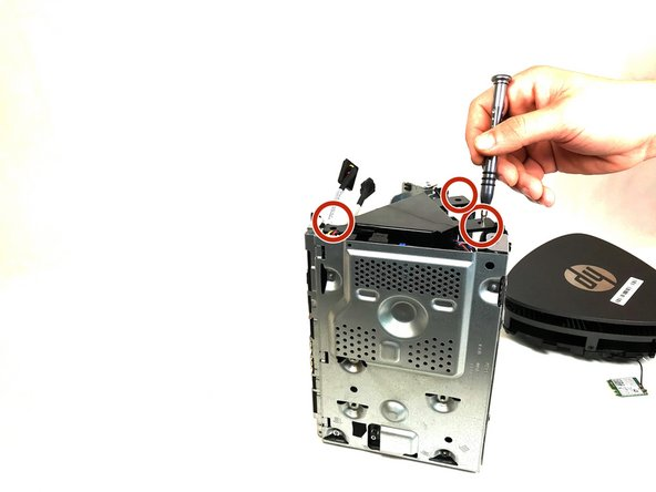 Remove the speaker by removing three 24 mm screws using the Torx Head #15 screwdriver and carefully lifting up and out from internal components.