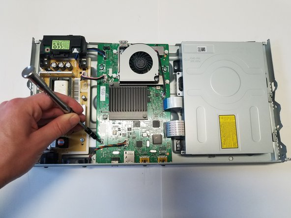 Three inner 6.5mm Phillips #1 screws hold the motherboard to the base of the frame, and must be unscrewed next.