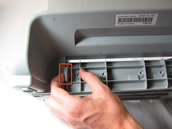 Be careful because the feed roller assembly is now loose, but it is still attached to the main body of the printer.