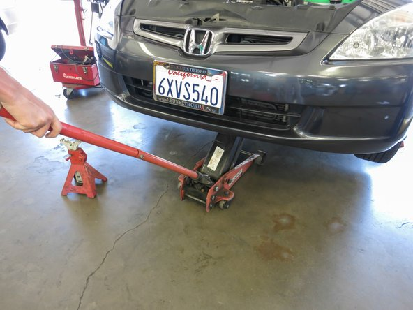 Place the Hydraulic Jack beneath the jack point.