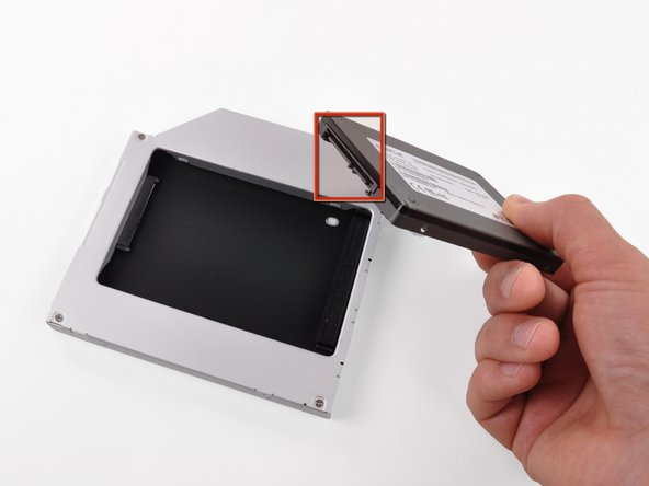Image 1/3: Make sure that the hard drive connectors are facing down before placing it into the enclosure.
