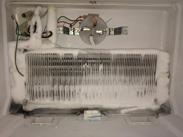 The evaporator was absolutely covered in ice. The intake for two air diffusers is covered in ice and this is preventing airflow from the freezer to the fridge. The evaporator needs to be defrosted for further trouble shooting. In this case a hairdryer accomplished this in a relative short time.