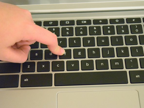 Image 1/1: Use your index finger to apply pressure onto the key until it clicks into place.