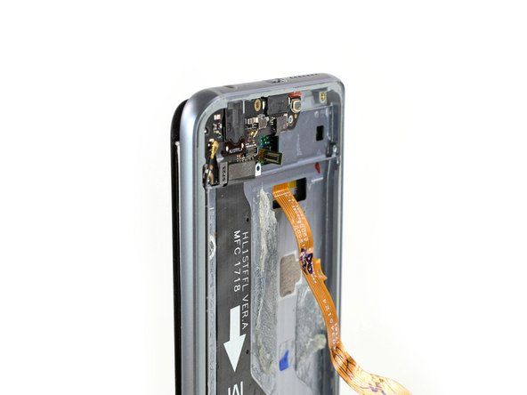 Make sure the display flex cable does not stick to the frame and carefully thread it through the gap at the bottom of the frame.