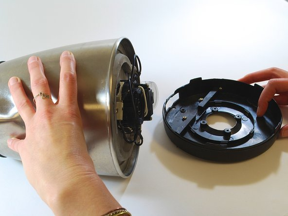 Using your hands, remove the kettle base by sliding it over the switch.