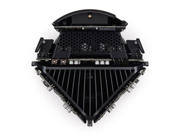 "A view from above: The Mac Pro utilizes a giant triangular heat sink (""Thermal Core""), shared by the dual graphics cards and CPU."