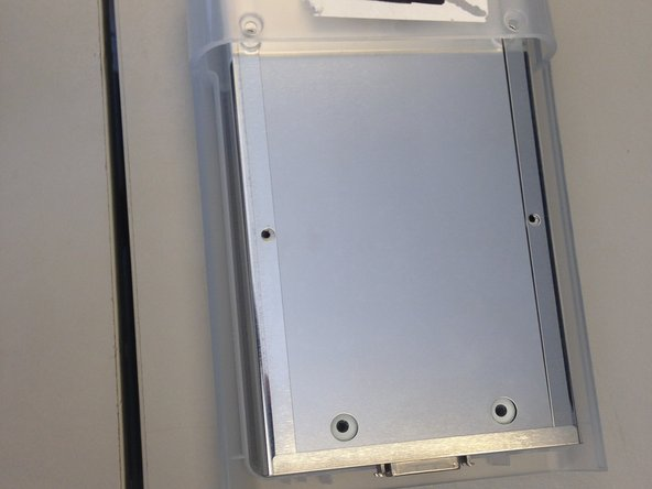 Image 2/2: Lift panel free of device.