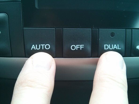 Image 1/3: On the heating/cooling control, press and hold  the AUTO and DUAL buttons.