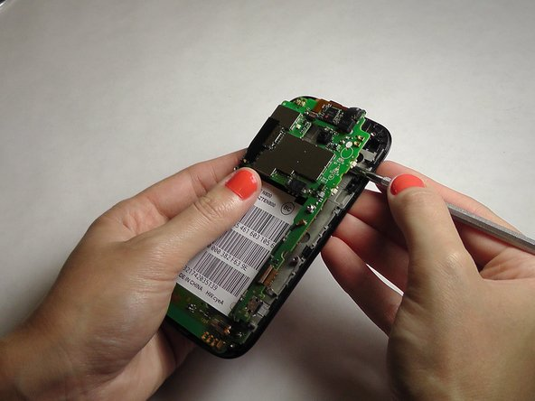 Gently pry the mid frame away from the rest of the phone to expose the motherboard.