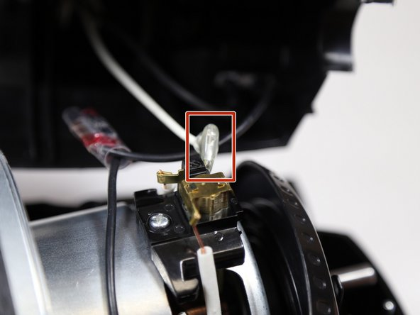 Make sure the vacuum is unplugged before touching any internal components.