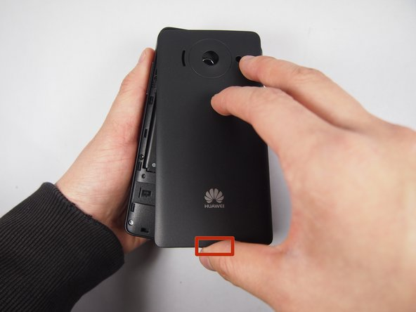 Remove the rear cover at the back by pulling the gap located at the bottom of the phone.