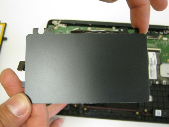 Remove touchpad from the opposite side of the metal plate.