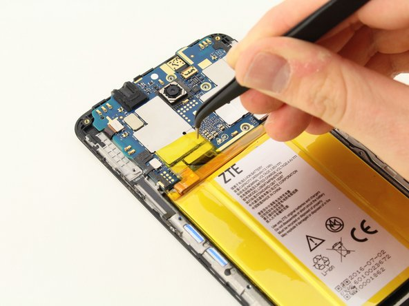 Use the tweezers to peel off the yellow Kapton tape.