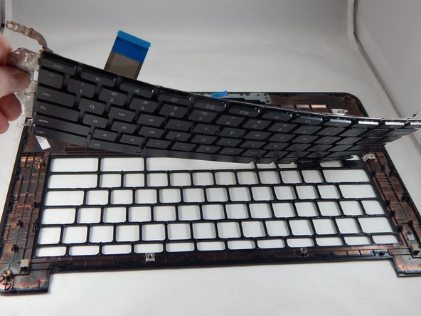 Separate the keyboard from the palm rest assembly.
