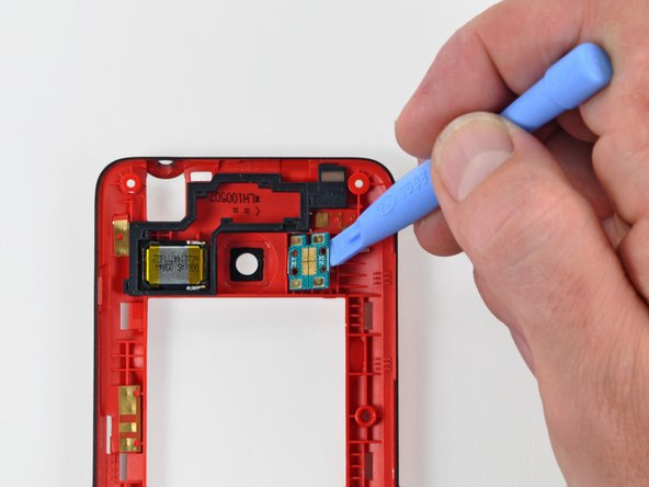 Use an iPod opening tool to pry the dual LED flash assembly off the posts securing it to the rear inner frame.