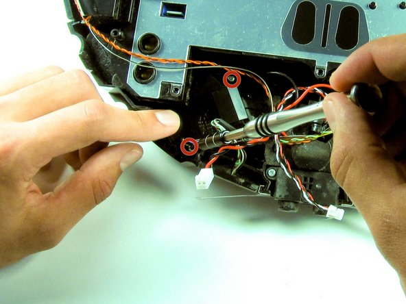 Use the Phillip's #1 screwdriver to remove the two 7.5 mm screws from the bumper sensor module.