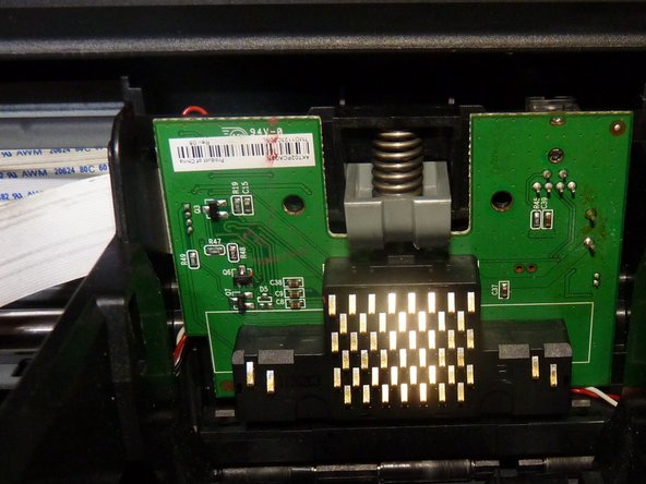 Image 1/3: Now is the time to re-seat the optical cable (Image 2 green) behind the top right of the board. Note it sits in between the clear plastic reader (Image 2 orange arrow) in a groove (Image 2 red depth indicators)