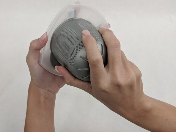 Turn the gray plastic filter clockwise and pull it upward.