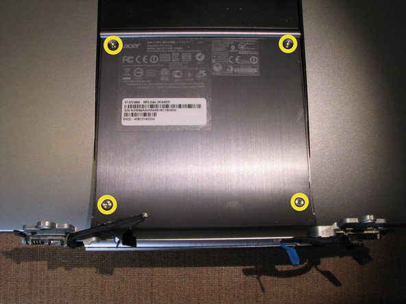 Image 1/3: Remove the 4 T9 torx screws from the display assembly where the model number and serial numbers stickers are located and swap that panel to the replacement display assembly.  Completing this step allows for your computer to retain its original identification information.