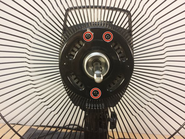 When reassembling the fan, remember to slide this half of the cage back on by aligning the holes in the metal center of the cage with the stumps sticking out on the fan.