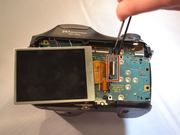Using tweezers, remove the LCD with the ribbon cable and set aside.