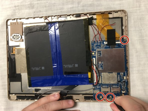 Use flathead screwdriver tool to remove the three 2.5 mm screws shown in the photo. Two screws are located at the base of the motherboard and there is one screw located at the top.