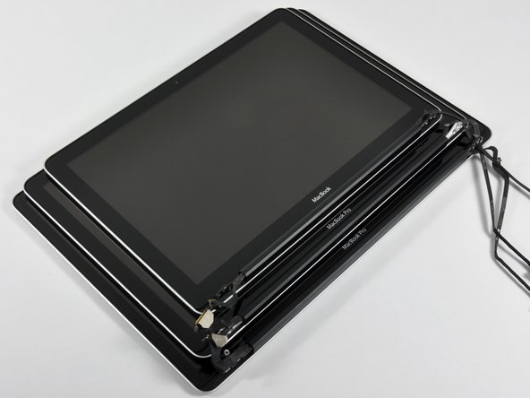 "Image 1/3: This photo is the 13"", 15"", and 17"" MacBook displays stacked together. [link