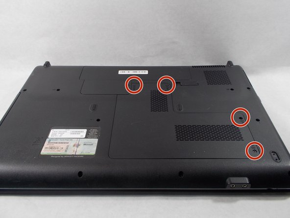 Unscrew the 4 circled screws using the PH1 screwdriver to release the cover plate. Remove the screws and set aside.