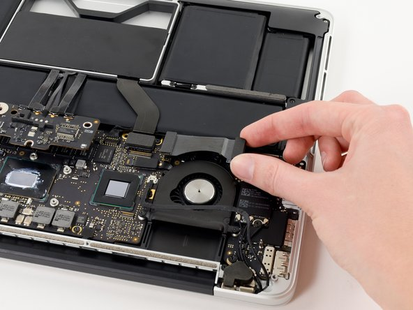 Lift and remove the I/O board data cable from the MacBook Pro.